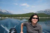 Jenna driving the boat on Lake Minnewanka